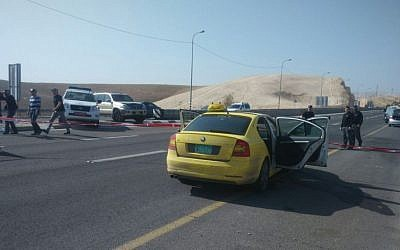 A Palestinian taxi at the scene of an attempted car-ramming and stabbing attack near Kfar Adumim, on Sunday November 22 2015. The driver was reportedly shot and killed after ramming into the car of an Israeli man, trying to stab him. (Courtesy)