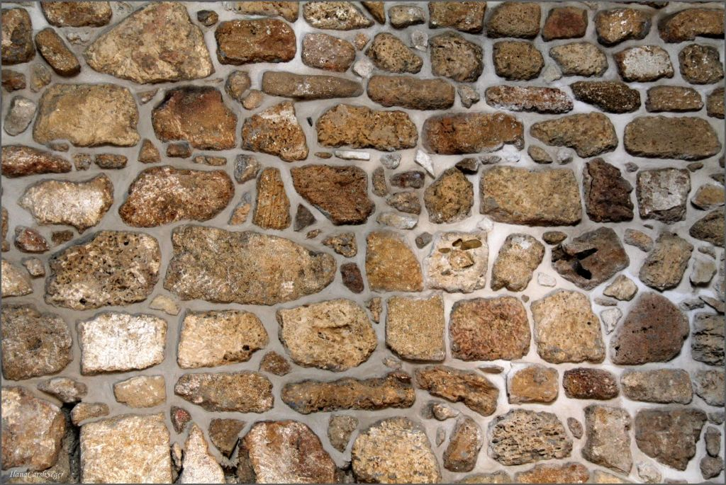 The mix of Ottoman and Crusader-era stones in one of the ancient walls in Evan Fallenberg's new Acre home (Courtesy Elana Seger)