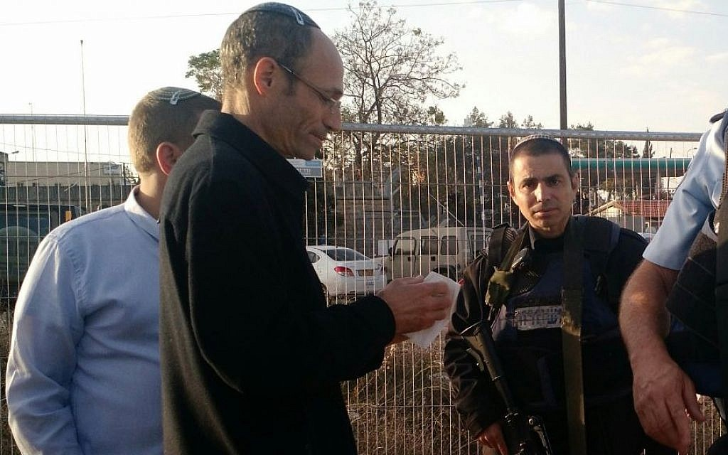 Davidi Perl, the head of the Etzion Regional Council at  the scene of a stabbing terror attack in the Etziyon Junction on Sunday, November 22, 2015. (Judah Ari Gross/Times of Israel)