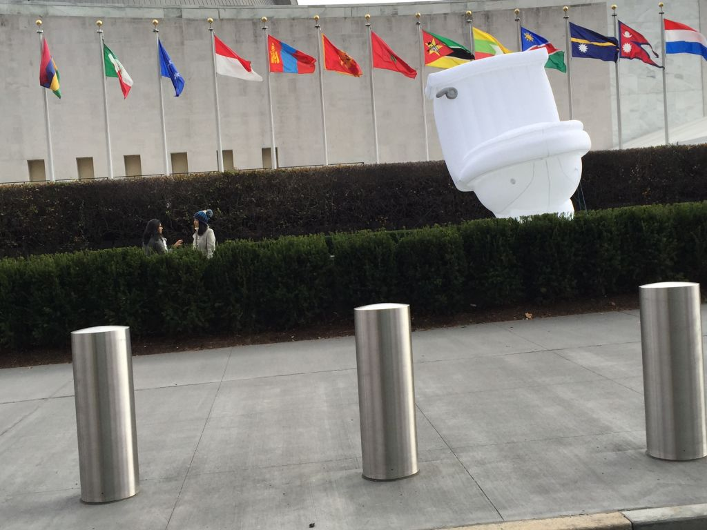 A giant inflatable toilet is set up outside the UN to mark World Toilet Day (Times of Israel staff)