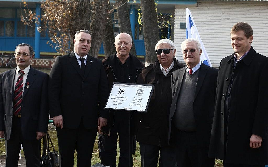 A delegation of Israelis and Ukranians commemorating the family of Yitzhak Rabin, in his father's hometown. (Jessica Steinberg/Times of Israel)