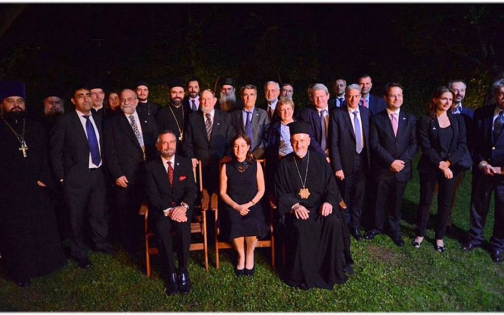 Jewish and Orthodox Christian clerics and scholars posing with the Israeli ambassador to Greece, Irit Ben-Abba, at an interfaith dialogue commemorating 25 years of formal relations between Israel and Greece. (Embassy of Israel in Athens/via JTA)