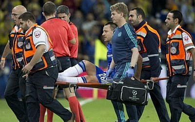 Chelsea's John Terry is taken on a stretcher during Group G Champions League soccer match against Maccabi Tel Aviv in Haifa, Israel, Tuesday, Nov. 24, 2015. (AP Photo/Ariel Schalit)