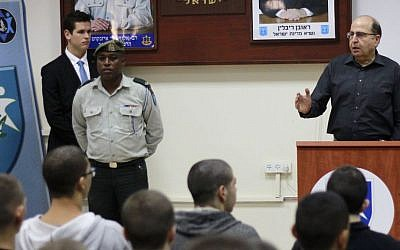Defense Minister Moshe Ya'alon addresses a group of new recruits at the IDF's enlistment center in Kiryat Ono outside of Tel Aviv on November 30, 2015. (Judah Ari Gross/Times of Israel)