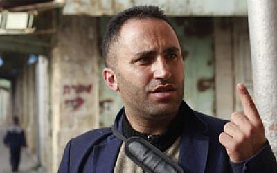 Issa Amro, who leads the 'Youths Against Settlements' organization, criticizes the Israeli government and Hebron's Jewish settlers in the old city, on November 5, 2015. (Judah Ari Gross/Times of Israel)