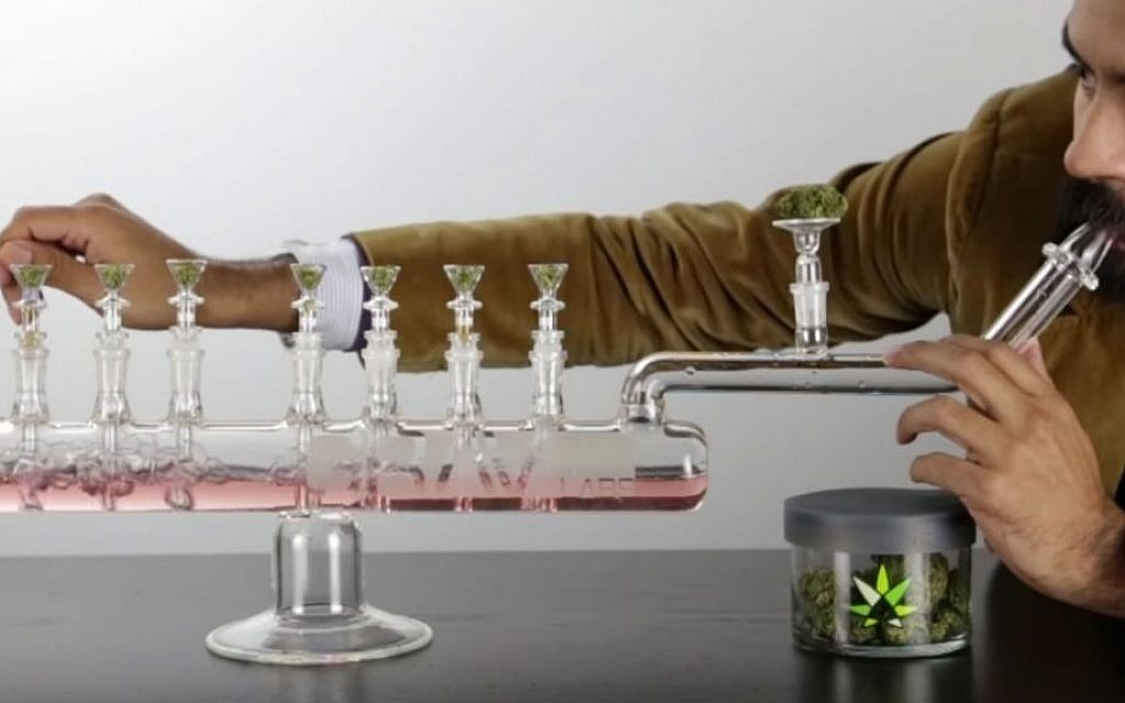 The Grav Menorah is a cross between a glass bong and a traditional hanukiah which retails for $699. (YouTube screenshot)