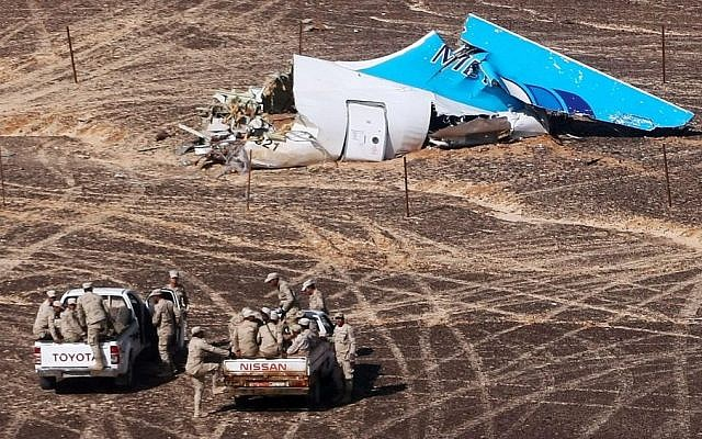 In this Sunday, Nov. 1, 2015 file photo provided by Russian Emergency Situations Ministry, Egyptian Military on cars approach a plane's tail at the wreckage of a passenger jet bound for St. Petersburg in Russia that crashed in Hassana, Egypt. (Maxim Grigoriev/Russian Ministry for Emergency Situations via AP, File)