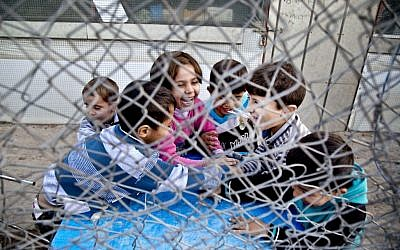 In this Saturday, Nov. 28, 2015 photo, Syrian refugee children play at a temporary refugee camp in Irbil, northern Iraq. Some 240,000 refugees who fled the fighting in Syria now live in Iraq. Their children are neither citizens of Syria, their families' country of origin, or of Iraq, the country where they now live. (Seivan M. Salim/AP)