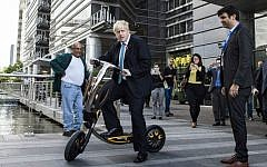 Mayor of London Boris Johnson rides an electric scooter during his visit to Tel Aviv, Israel, November 9, 2015. (AP Photo/Dan Balilty)