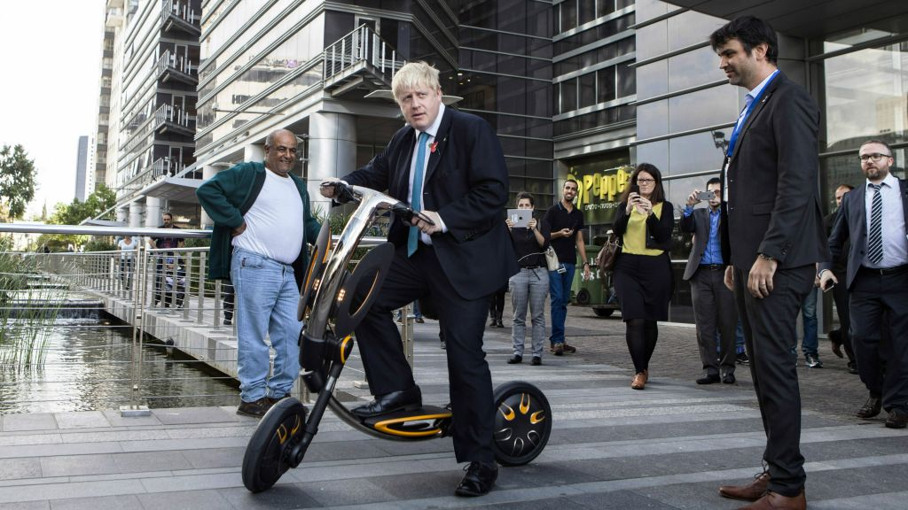 Mayor of London Boris Johnson rides an electric scooter during his visit to Tel Aviv, Israel, Monday, Nov. 9, 2015. (AP Photo/Dan Balilty)