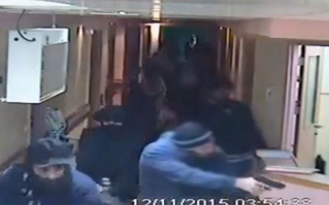 Image from a CCTV video released by al-Ahli Hospital in Hebron shows an arrest raid seeking a stabbing suspect by Israeli forces disguised in fake beards, November 12, 2015. (al-Ahli Hospital via AP)