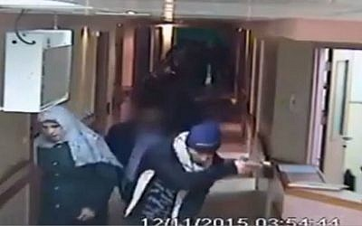 This image made from CCTV video released by Al-Ahli Hospital shows an arrest raid seeking a stabbing suspect by Israeli forces, one disguised as a pregnant Muslim woman, and others disguised in fake beards in Hebron on Thursday, Nov. 12, 2015. (Al-Ahli Hospital via AP)