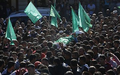 Palestinian mourners carry the body of 27-year-old Abdallah Shalaldeh during his funeral in the West Bank village of Sa'ir, near Hebron, November 12, 2015. (AP/Nasser Shiyoukhi)