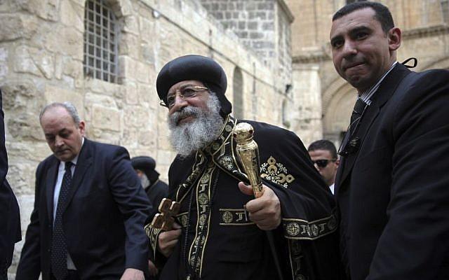 The leader of Egypt's Coptic Orthodox Church Pope Tawadros II walks outside the Church of Holy Sepulcher in Jerusalem, Saturday, Nov. 28, 2015. (AP/Mahmoud Illean)