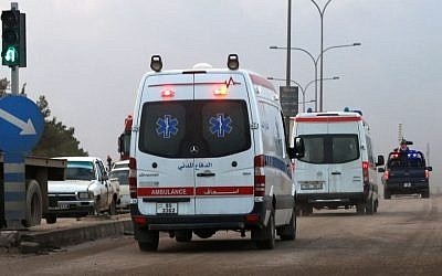 Ambulances leave the King Abdullah bin Al Hussein Training Center where a Jordanian policeman went on a shooting spree in Mwaqar on the outskirts of Amman, Jordan, Monday, Nov. 9, 2015. The policeman opened fire Monday on foreign trainers at a police compound, killing two Americans, a South African and a Jordanian and wounding two Americans and three Jordanians, according to government spokesman Mohammed Momani. (AP Photo/Raad Adayleh)