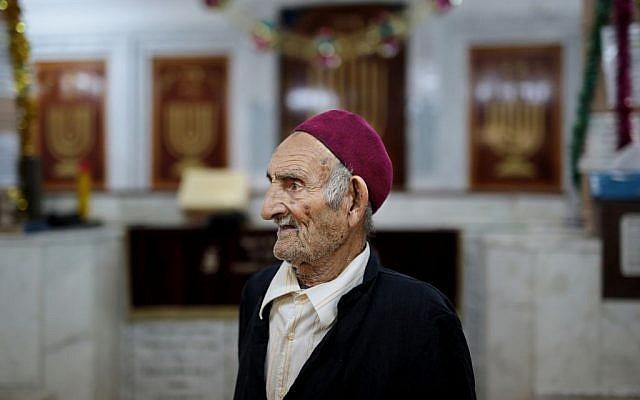 A caretaker of the Synagogue of the Kohanim of Djirt, pauses before prayers, at Hara Kbira, the main Jewish neighborhood on the Island of Djerba, southern Tunisia, October 29, 2015. (Photo by AP Photo/Mosa'ab Elshamy)