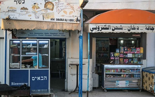 Yona Sabbagh, 38, works in his Brik restaurant at Hara Kbira, the main Jewish neighborhood on the Island of Djerba, southern Tunisia, October 29, 2015. (Photo by AP Photo/Mosa'ab Elshamy)