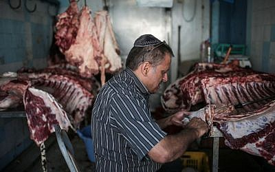Char Haddad, 45, prepares meat in his kosher slaughterhouse at Hara Kbira, the main Jewish neighborhood on the Island of Djerba, southern Tunisia, October 29, 2015. (Photo by AP Photo/Mosa'ab Elshamy)