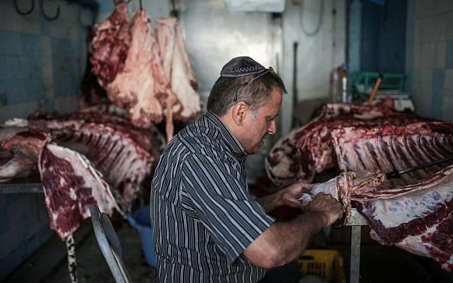 Char Haddad, 45, prepares meat in his kosher slaughterhouse at Hara Kbira, the main Jewish neighborhood on the Island of Djerba, southern Tunisia, October 29, 2015. (Photo by AP Photo/Mosa'ab Elshamy)