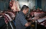 Illustrative image of a man preparing meat at a kosher slaughterhouse (AP Photo/Mosa'ab Elshamy)