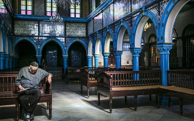 A Jewish man rests in La Ghriba, the oldest synagogue in Africa, on the Island of Djerba, southern Tunisia, October 29, 2015.
