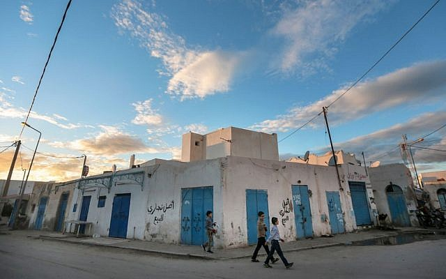 Boys walk past closed shops on the beginning of Shabbath, after sunset, at Hara Kbira, the main Jewish neighborhood in the Island of Djerba, southern Tunisia, October 29, 2015. (Photo by AP Photo/Mosa'ab Elshamy)