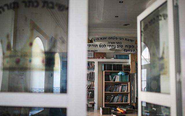 Jewish holy books are seen at a library at Hara Kbira, the main Jewish neighborhood on the Island of Djerba, southern Tunisia, October 29, 2015. (Photo by AP Photo/Mosa'ab Elshamy)