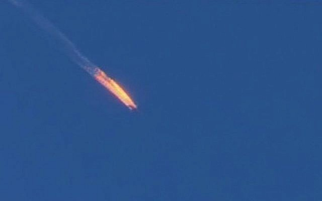 Screen capture from video by Haberturk TV showing a Russian warplane on fire before crashing on a hill as seen from Hatay province, Turkey, November 24, 2015. (Haberturk TV via AP)