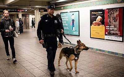 A police officer patrolling the Times Square subway stop in New York City the day after a series of terrorist attacks in Paris, on November 14, 2015. (Andrew Renneisen/Getty Images via JTA)