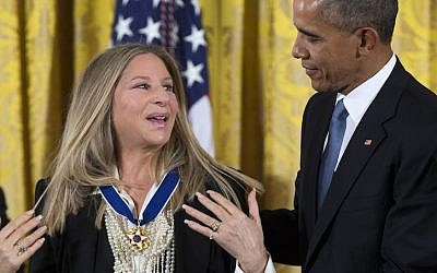 US President Barack Obama, right, presents the Presidential Medal of Freedom to Barbra Streisand during a ceremony in the East Room of the White House, on Tuesday, Nov. 24, 2015 (AP Photo via JTA/Evan Vucci)