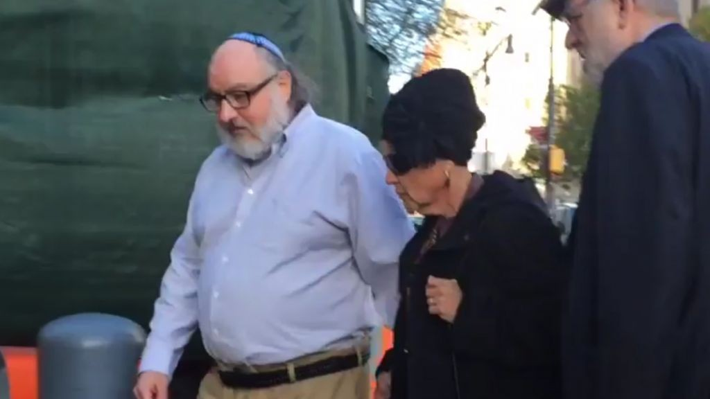 In this still image from video provided by WCBS-TV, convicted spy Jonathan Pollard, left, arrives at a federal courthouse in New York with his wife, Esther, to check in at a probation office just hours after he was released from prison on Friday, Nov. 20, 2015. (Ilana Gold/WCBS-TV via AP)