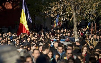 Thousands walk during a mourning march for the victims of the Colectiv nightclub fire in Bucharest, Romania, Sunday, Nov. 1, 2015. (AP Photo/Vadim Ghirda)