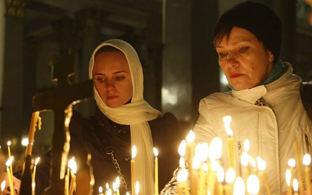 People light candles inside an Orthodox church in St. Petersburg during a day of national mourning for the plane crash victims, Russia, on Sunday, Nov. 1, 2015  (AP/Dmitry Lovetsky)