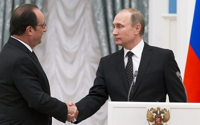 Russian President Vladimir Putin, right, and France's President Francois Hollande shake hands after their news conference following the talks in Moscow, Russia, November 26, 2015. (AP/Alexander Zemlianichenko/Pool)