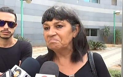 Ruti Malka, daughter of an 80-year-old woman stabbed in a Rishon Lezion terror attack, speaks to the press on November 3, 2015. (screen capture: Channel 2)
