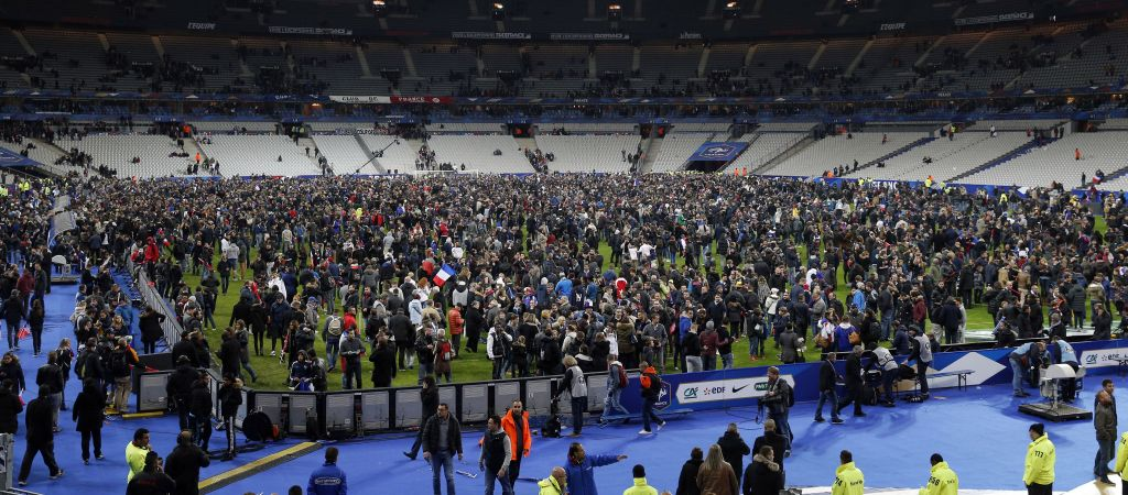 Spectators invade the pitch of the Stade de France stadium after the international friendly soccer France against Germany, Friday, November 13, 2015 in Saint Denis, outside Paris. During the first half of France's soccer match against Germany on Friday, two explosions went off nearby. (Photo by AP Photo/Michel Euler)