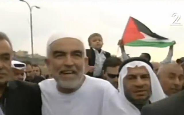 Islamic Movement Northern Branch head Raed Salah (center), and MK Jamal Zahalka (left) march in a demonstration on November 28, 2015 (Channel 2 screenshot)