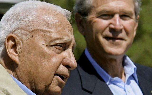 US President George W. Bush listening to Israeli Prime Minister Ariel Sharon, left, speaking at a joint news conference following their talks about the Middle East peace process at Bush's ranch in Crawford, Texas, April 11, 2005. (J. Scott Applewhite/AP Images/JTA)