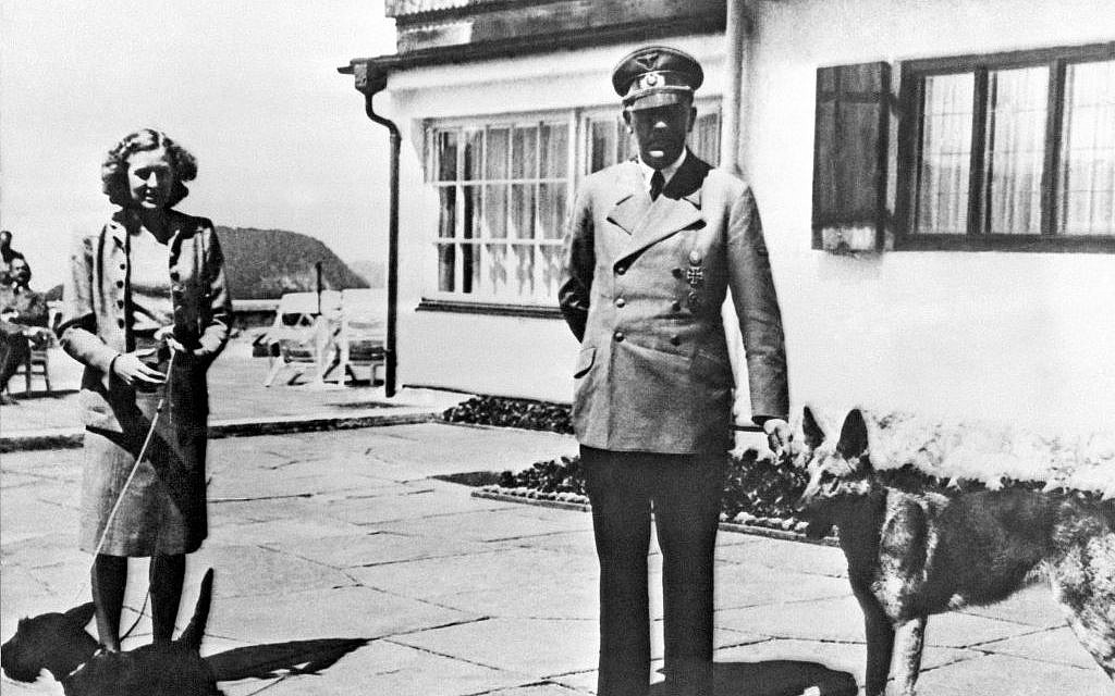 Undated file photo shows Adolf Hitler (right), and his mistress Eva Braun posing on the terrace of the Berghof, in Berchtesgeden, Germany. (AP, File)