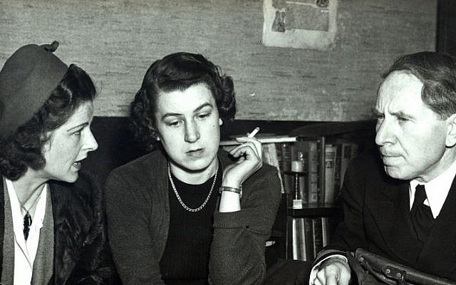 """This undated photograph provided courtesy of Duquesne University/Musmanno Collection shows Trudl Junge, center, with Judge Michael Musmanno, right, and an unidentified interpreter included in the documentary film, """"The Day Hitler Died."""" (Duquesne University/Musmanno Collection via AP)"""