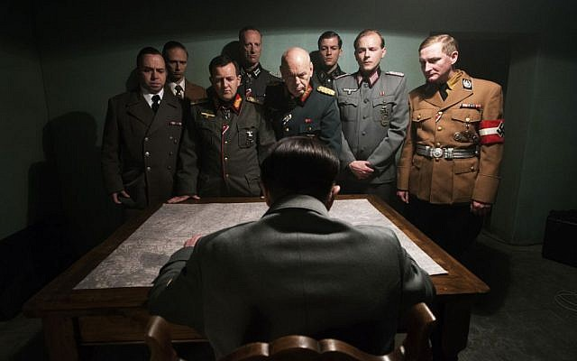 """This photo provided by the Smithsonian Channel shows, an actor portraying Adolf Hitler, seated, addressing his top generals in the new Smithsonian Channel special, """"The Day Hitler Died."""" (Smithsonian Channel via AP)"""