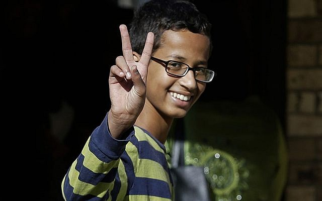 This Sept. 17, 2015, file photo shows Ahmed Mohamed, 14, gestures as he arrives to his family's home in Irving, Texas. (AP Photo/LM Otero, File)