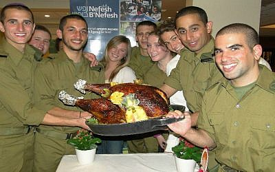 Lone soldiers and new immigrants from North America celebrate Thanksgiving. (Courtesy photo/NBN/Laura Ben-David)
