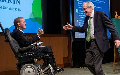 Rep. Jim Langevin, left, of Rhode Island greeting former Iowa Sen. Tom Harkin at the Ruderman Foundation Inclusion Summit in Boston, November 2015. (Noam Galai/via JTA)