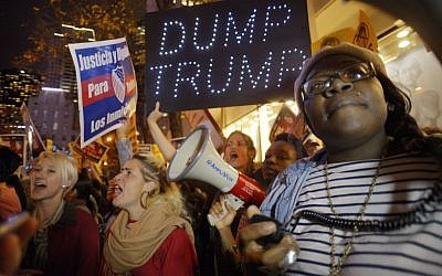 Sasha Murphy, of the ANSWER Coalition, leads demonstrators in a chant during a protest against Republican presidential candidate Donald Trump's hosting 'Saturday Night Live' in New York, November 7, 2015. (AP/Patrick Sison)