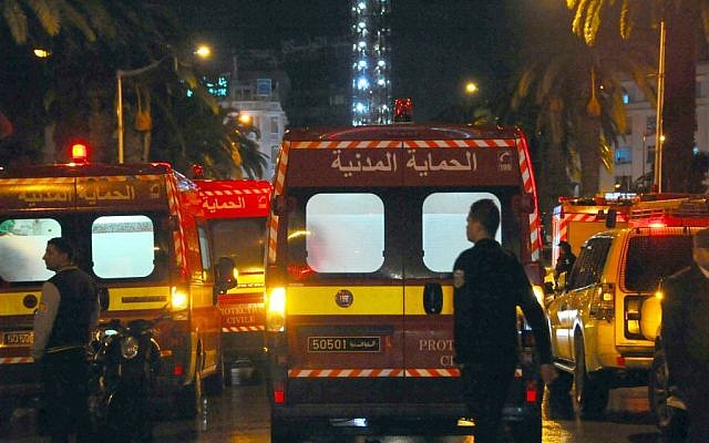 Ambulances and police vans are seen at the scene of a bus explosion in the center of the capital, Tunis, Tunisia, Tuesday, November 24, 2015 (AP/Hassene Dridi)