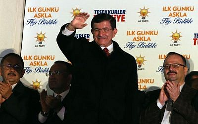 Turkish Prime Minister Ahmet Davutoglu salutes supporters gathered outside ruling Justice and Development Party headquarters in Ankara, Turkey, Sunday, Nov. 1, 2015. (AP/Burhan Ozbilici)