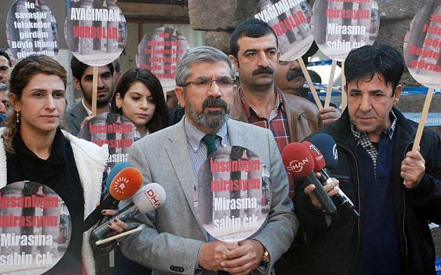 Tahir Elci, the head of Diyarbakir Bar Association, speaks to the media shortly before being killed in Diyarbakir, Turkey, Saturday, Nov. 28, 2015. (IHA agency via AP)