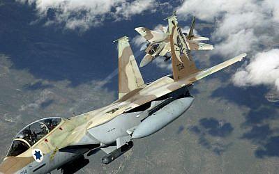 Illustrative: Two Israeli Air Force F-15 Ra'ams practicing air maneuvers. (TSGT Kevin J. Gruenwald, USAF/Wikipedia)