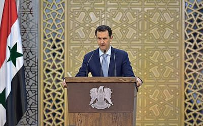 Syrian President Bashar Assad delivers a speech in Damascus, Syria, July 26, 2015. (SANA via AP, File)